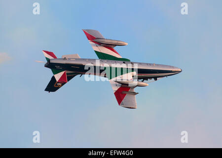 Military aviation. Aermacchi MB-339 of the Frecce Tricolori aerobatic team flying inverted during a display - Stock Photo