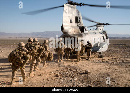 US Marines load onto a CH-46 Sea Knight Helicopter during an Integrated Training Exercise June 20, 2013 at Marine - Stock Photo