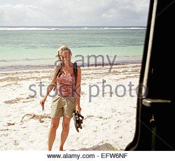 Young Woman Sunbathing Caucasian Tourist (Who Is This Interesting Man In Strange Car) - Kenya - Republic of Kenya - Stock Photo