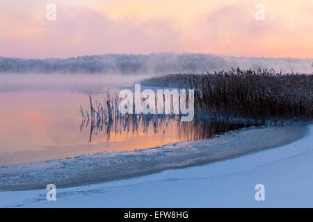 Misty lake in winter,  Masuria, Poland, Europe. - Stock Photo
