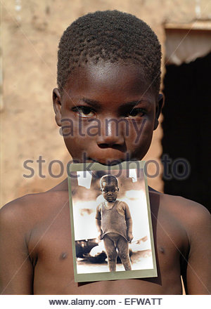 Same Child in 2000 and 2007 - I photographed this boy in 2000 and found him again in 2007 (and gave him a photo - Stock Photo