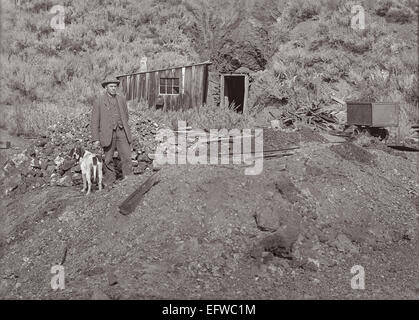 Historic photo of a miner and his dog at a mine in Idaho, United States - The mine was possibly located in the Wood - Stock Photo