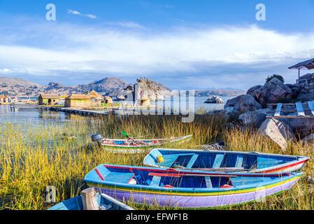 Colorful boats near floating islands on Lake Titicaca near Copacabana, Bolivia - Stock Photo