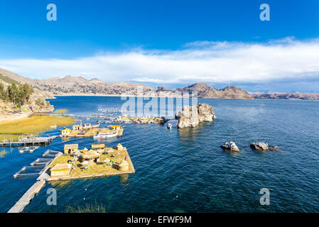 Three floating islands on Lake Titicaca near Copacabana, Bolivia - Stock Photo