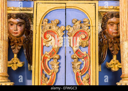 Details in cherubs in an old historic chapel in rural Bolivia - Stock Photo