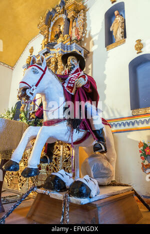 Statue of Saint James the Moor Slayer in an old historic chapel in rural Bolivia - Stock Photo