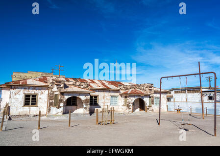 Schoolyard in the ghost town of Humberstone, Chile - Stock Photo