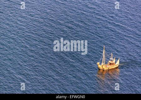 Reed boat, or totora, on Lake Titicaca near the Isla del Sol in Bolivia - Stock Photo