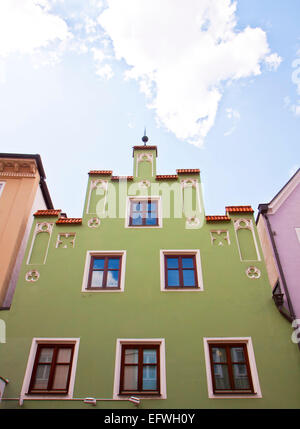 Typical house in  Landshut in Renaissance architecture style and pastel colors. - Stock Photo