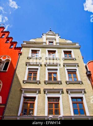 Typical houses in Landshut in Renaissance architecture style and bold colors - Stock Photo