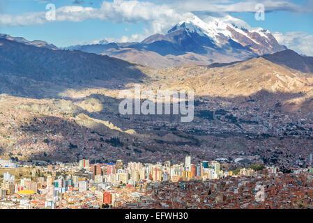 Cityscape of La Paz, Bolivia with Illimani Mountain rising in the background - Stock Photo