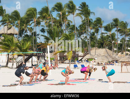 DOMINICAN REPUBLIC. Holidaymakers doing keep-fit exercises on Punta Cana beach. 2015. - Stock Photo