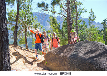 Family hiking on mountain path - Stock Photo