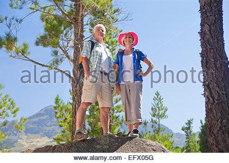 Portrait of senior couple on mountain path - Stock Photo