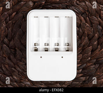 White battery charger. Power source. - Stock Photo