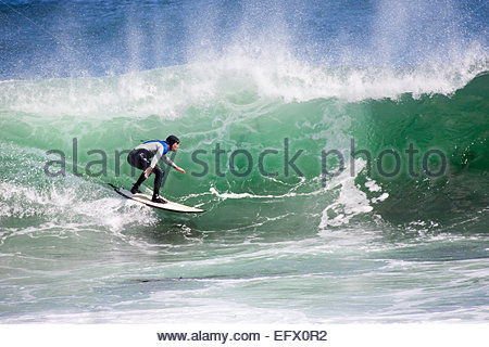 Surfer riding large wave - Stock Photo