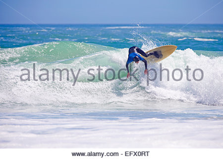 Surfer, losing balance, riding large wave - Stock Photo