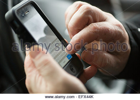 Newport area Wales UK Iphone Mans Hand United Kingdom Great Britain British UK Cardiff Wales area People Person - Stock Photo