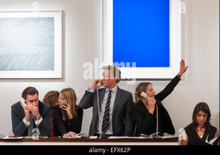 Sotheby's, London, UK. 10 February 2015. In front of (L to R) Cy Twombly's 'Rome', sold for £3.085m and Yves Klein's - Stock Photo
