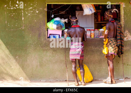 Two Men From The Hamer Tribe Buying Goods From A Shop In Turmi, Omo Valley, Ethiopia - Stock Photo