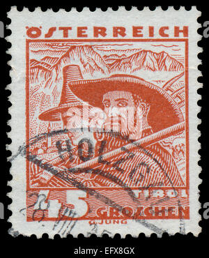 AUSTRIA - CIRCA 1934: A stamp printed in Austria shows Tirol - man and woman in national costume, circa 1934 - Stock Photo