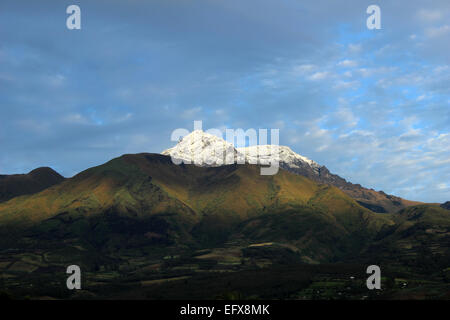 The snow capped summit of the dormant volcano, Mount Cotacachi, in the Andes Mountains near Cotacachi, Ecuador - Stock Photo