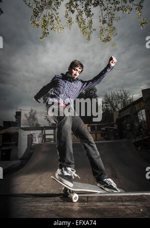 Skateboarding on mini ramp, Smith grind, Berlin, Germany