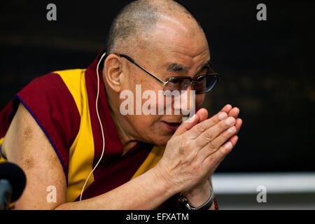 Copenhagen, Denmark. 11th February, 2015. Dalai Lama greets the press during his press conference at the Bella Sky - Stock Photo