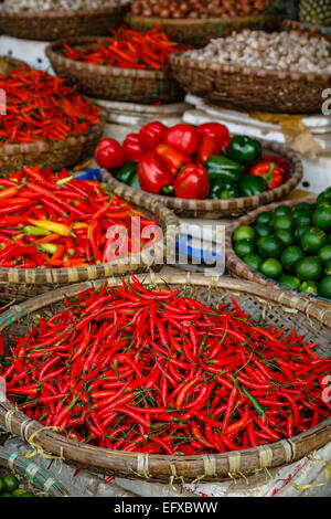 Red chillies stall at a market in the old quarter, Hanoi, Vietnam. - Stock Photo