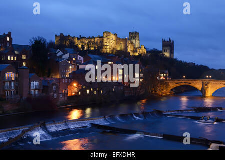 Durham Castle and Cathedral alongside the River Wear at night - Stock Photo