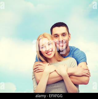 smiling couple hugging - Stock Photo