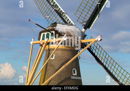Detail of a windmill with fresh snow on its thatched roof on a sunny day in winter, Voorhout, South Holland, The - Stock Photo