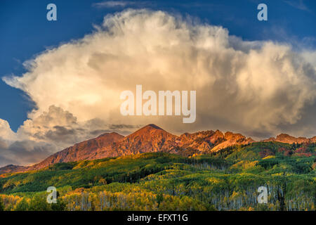 Gunnison National Forest, CO: Billowing clouds over the Ruby Range in early fall - Stock Photo