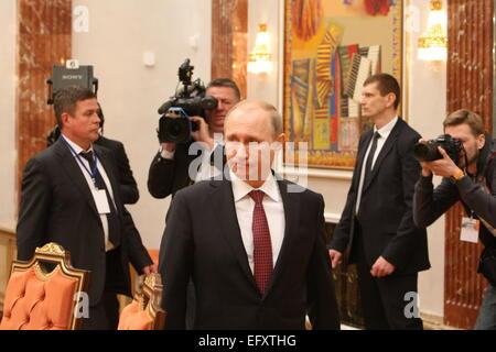 Minsk, Belarus. 11th Feb, 2015. Russian President Vladimir Putin (C, front) arrives for the four-way peace talks - Stock Photo