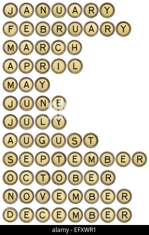 twelve months  from January to December in isolated vintage typewriter keys - Stock Photo