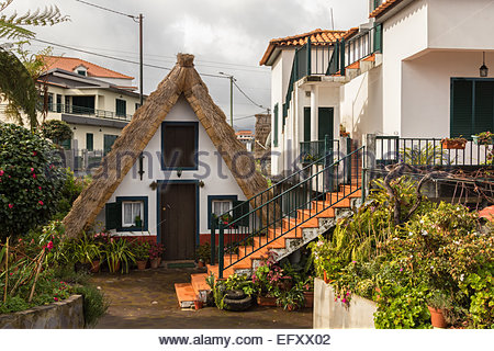A traditional triangular straw thatched house known as a Palheiros in Santana Portugal. - Stock Photo