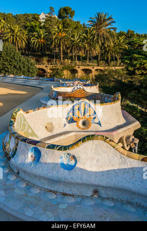 Multicolored mosaic bench at Park Guell or Parc Guell, Barcelona, Catalonia, Spain - Stock Photo