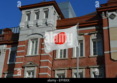 Japanese Flag in front of the Tokyo Railway Station. - Stock Photo