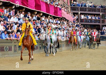 Horses and riders before the start of the historical horse race Palio di Siena, Piazza del Campo, Siena, Tuscany, - Stock Photo