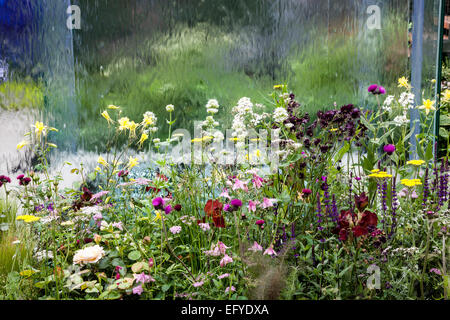 Pavilion with transparent water wall and mixed naturalistic planting - Stock Photo