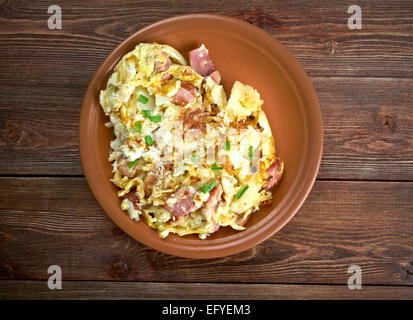 Bauernfruhstuck Farmer's breakfast. German country breakfast dish made from fried potatoes, eggs, onions, leeks - Stock Photo