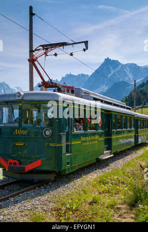 The Mont Blanc mountain cog train with the Aiguille du Midi behind, at Bellevue, near Chamonix, French Alps, France - Stock Photo