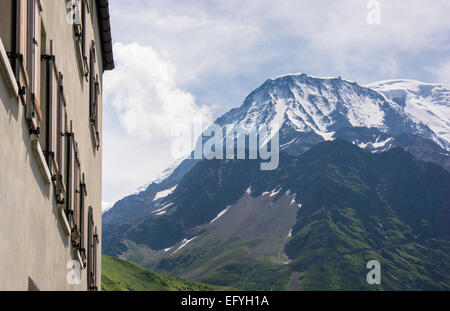 Aiguille du Gouter on Mont Blanc mountain peak and the Bellevue Hotel, above the Chamonix Valley, Haute-Savoie, - Stock Photo