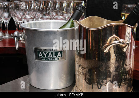 Bottles in champagne buckets - Stock Photo