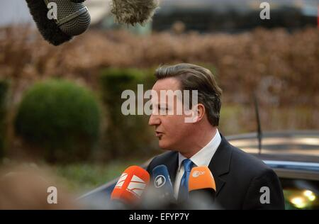 Thursday. 12th Feb, 2015. British Prime Minister David Cameron speaks with the media after his arrival to an EU summit in Brussels on Thursday, February 12, 2015. EU leaders meet for a one-day summit to discuss the crisis in Ukraine and fighting against terrorism. Credit:  Jakub Dospiva/CTK Photo/Alamy Live News