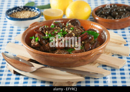 Afelia. Pork with red wine and coriander seed. - Stock Photo