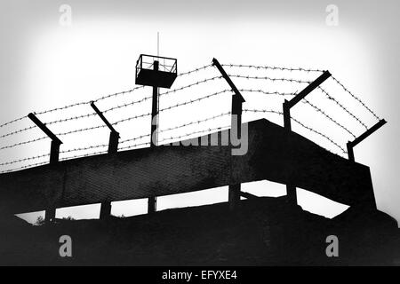 Prison walls with barbed wire - Stock Photo