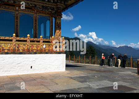 BU00102-00...BHUTAN - Tourist taking in the view of the Bhutanese Himalayas from the balcony of the Druk Wangyal - Stock Photo