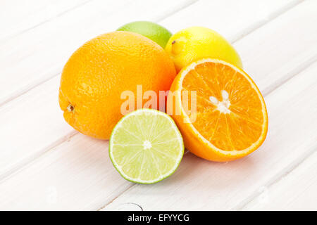 Citrus fruits. Oranges, limes and lemons. Over wooden table background - Stock Photo