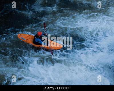 Kayaker on the River Dee at Llangollen, from the bridge - Stock Photo
